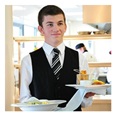 young man waiting tables