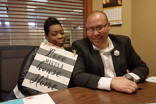 Joshua Johnson and his wife Michelle celebrating the closing on their first home.